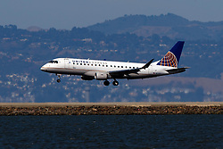 Embraer ERJ-175LR (N117SY) operated by SkyWest Airlines for United Express landing at San Francisco International Airport (KSFO), San Francisco, California, United States of America