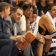Skylar Diggins, Tulsa Shock, peers out from the bench  during the Connecticut Sun V Tulsa Shock WNBA regular game at Mohegan Sun Arena, Uncasville, Connecticut, USA. 2nd July 2013. Photo Tim Clayton