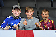 Three young boys from Ipswich give a thumbs up during the EFL Sky Bet League 1 match between Milton Keynes Dons and Ipswich Town at stadium:mk, Milton Keynes, England on 17 September 2019.