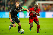 Liverpool forward Sadio Mané (10) holds off Red Bull Salzburg defender Rasmus Kristensen (43) during the Champions League match between FC Red Bull Salzburg and Liverpool at the Red Bull Arena, Salzburg, Austria on 10 December 2019.
