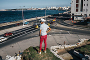 Standing on top of this rock wall overlooking the Malecón at the Hotel Nacional de Cuba, a spot reserved for tourists, typically invites security and a prompt ejection. These are everyday small acts of defiance.