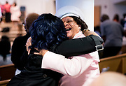 Elzola Stanley embraces a fellow churchgoer during Easter service at Mt. Zion Baptist Church in Madison, WI on Sunday, April 21, 2019.