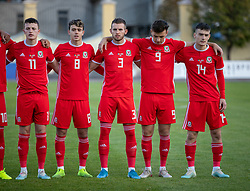 ORHEI, MOLDOVA - Friday, October 11, 2019: Wales players line-up for the national anthem before the UEFA Under-21 Championship Italy 2019 Qualifying Group 9 match between Moldova and Wales at the Orhei District Sports Complex. L-R Nathan Broadhead, Robbie Burton, Rhys Norrington-Davies, Mark Harris, Dylan Levitt. (Pic by Kunjan Malde/Propaganda)