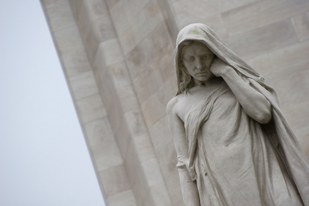 "Close up of the statue of the weeping woman or better known as ""Mother Canada mourning her dead"" at the ‪Canadian National Vimy Memorial‬ dedicated to the memory of Canadian Expeditionary Force members killed in World War one. The monument is situated at a 100 hectare preserved battlefield with wartime tunnels, trenches, craters and unexploded munitions. The memorial designed by Walter Seymour Allward opened in 1936."