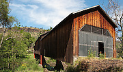 Honey Run Covered Bridge was built in 1894 on Butte Creek, halfway between Chico and Paradise in Butte County, California, USA. Pedestrians and bicycles can cross, but a damaging car crash in 1965 closed the bridge to auto traffic, which was rerouted to a steel bridge upstream. Panorama stitched from 3 overlapping photos.