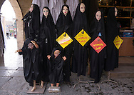 """Iran, Tehran Province, Tehran, mannequins with black clothes. Islamic Sharia law was implemented during the 1979 revolution. Since then, women have been forced to cover their hair and wear long, loose-fitting clothes to """"maintain their modesty"""". Black clothing is recommended, but the younger generation likes to break the rules."""