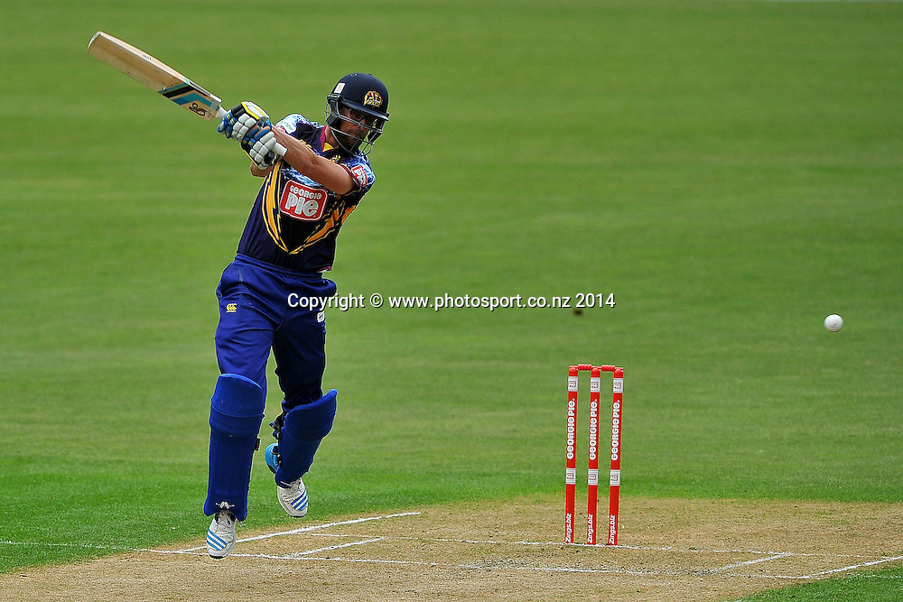 Sam Wells of the Otago Volts plays a shot, during the Georgie Pie Twenty20 match between the Otago Volts and the Canterbury Kings, held at the University Oval, Dunedin, New Zealand, 20 November 2014. Credit: Joe Allison / www.photosport.co.nz