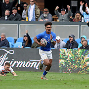 Manu Samoa's Joe Perez personally took out half the England 7's team in his first half try, bringing great delight to all fans in attendance.  Manu Samoa and England tied 14-14 on the first day of the Silicone Valley 7's, Avaya Stadium, San Jose, California, USA.  Photo by Barry Markowitz, 4pm