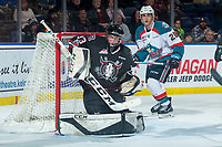 KELOWNA, CANADA - FEBRUARY 14: Riley Lamb #33 of the Red Deer Rebels makes a second period save as Leif Mattson #28 of the Kelowna Rockets looks for the rebound  on February 14, 2018 at Prospera Place in Kelowna, British Columbia, Canada.  (Photo by Marissa Baecker/Shoot the Breeze)  *** Local Caption ***