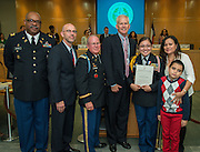 L-R: Lt. Col. Cornell McGhee, Michael McDonough, Lt. Col. Dennis O'Driscoll, Houston ISD trustee Michael Lunceford, Bellaire High School JROTC cadet Bianca Rubio Casteneda and her family pose for a photograph during the Board of Education meeting, October 9, 2014.