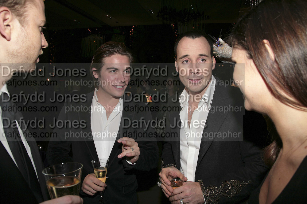 Kevin Zegeas and David Furnish, THE CHRISTMAS PARTY CELEBRATING THE 225TH ANNIVERSARY OF ASPREY. 167 NEW BOND ST. LONDON W1. 7 DECEMBER 2006. ONE TIME USE ONLY - DO NOT ARCHIVE  © Copyright Photograph by Dafydd Jones 248 CLAPHAM PARK RD. LONDON SW90PZ.  Tel 020 7733 0108 www.dafjones.com