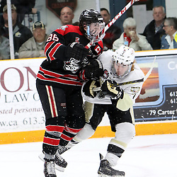 TRENTON, ON - Apr 18, 2016 -  Ontario Junior Hockey League game action between Trenton Golden Hawks and the Georgetown Raiders. Game 3 of the Buckland Cup Championship Series, at the Duncan Memorial Gardens in Trenton, Ontario.Andrew Court #88 of the Georgetown Raiders and Brandon Marinelli #7 of the Trenton Golden Hawks battles for control during the second period<br /> (Photo by Ed McPherson / OJHL Images)