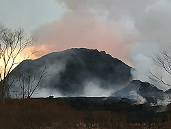 June 15, 2018 - Hawaii, U.S. - Lava fountains from Fissure 8 reach heights of 200 ft overnight. The cinder and spatter cone that is building around the fissure is now about 165 ft at its highest point. At times, fissure activity is hidden behind the cinder and spatter cone, as shown in this image. USGS image taken June 15, 2018. (Credit Image: © USGS/ZUMA Wire/ZUMAPRESS.com)