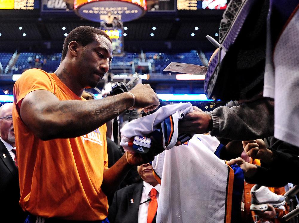 Jan. 7 2011; Phoenix, AZ, USA; New York Knicks forward Amar'e Stoudemire signs autographs for fans at the US Airways Center. The Knicks defeated the Suns 121-96. Mandatory Credit: Jennifer Stewart-US PRESSWIRE.