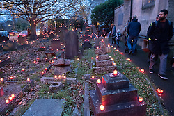 "© Licensed to London News Pictures. 16/11/2019. Bristol, UK. ""Light the Night"" in the grounds of St Paul's Church churchyard on Coronation Road with a sea of light as 5,000 candles are lit for the inaugural Light the Night event. Shielded candles were placed around the churchyard by volunteers to create a event for everybody to come and celebrate family and remembrance of loved ones. Attendees could buy and light a candle in remembrance of their loved ones. The event was inspired by the celebrations of All Souls Day and the tradition of Eastern European churches. Photo credit: Simon Chapman/LNP."