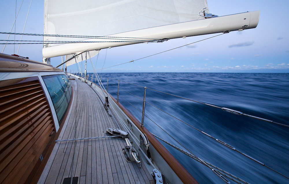 A large sailing yacht speeds across the Atlantic Ocean on a voyage to Europe by way of the Azores.