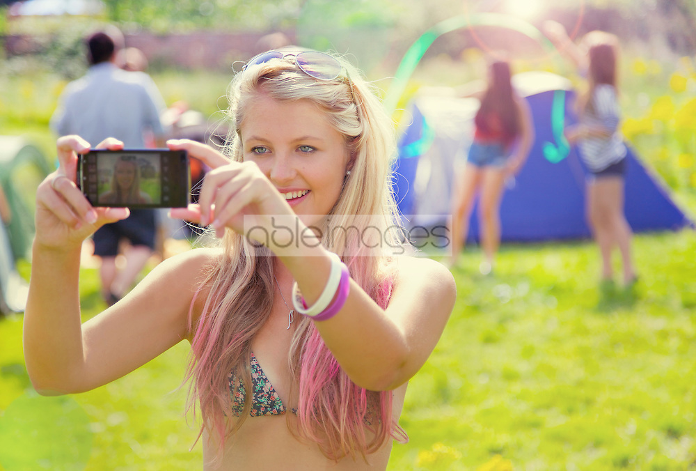 Teenage Girl Taking Self Portrait Photo