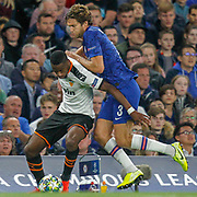 Chelsea defender Marcos Alonso (3) collides with Valencia midfielder Geoffrey Kondogbia (6) during the Champions League match between Chelsea and Valencia CF at Stamford Bridge, London, England on 17 September 2019.