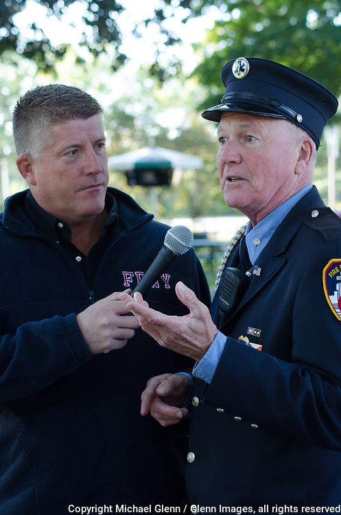 1 Oct 2017 Elmont, New York United States of America //  EMT Liam Glinane of the FDNY ceremonial unit being interviewed by Firehouse Kitchen host, Raymond Cooney at the 3RD annual national stair climb for fallen firefighters at the Belmont Park racetrack  Michael Glenn  /   for the FDNY
