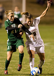 Loyola midfielder Colleen Kinealy (21) and Virginia forward/midfielder Kelly Quinn (10) fight for the ball.  The Virginia Cavaliers defeated the Loyola (MD) Greyhounds 4-1 in the first round of the NCAA Women's Soccer tournament held at Klockner Stadium in Charlottesville, VA on November 16, 2007.