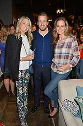 Left to right, ARABELLA DUNN and HARRY & CHARLOTTE LAWSON-JOHNSTON at a party to celebrate the publication of Flourish by Willow Crossley held at OKA, 155-167 Fulham Rd, London on 4th October 2016.