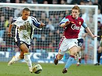 Photo: Ed Godden.<br />Aston Villa v Portsmouth. The Barclays Premiership. 04/03/2006. <br />Wayne Routledge (L) and Villa's Steven Davis battle.