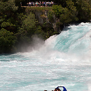 The Huka Falls Jet boat at the Huka Falls..The Huka Falls are the largest falls on the Waikato River, near Taupo on New Zealand's North Island..They are the most visited natural attraction in New Zealand!.The Waikato river is one of New Zealand's longest rivers and it drains Lake Taupo - the largest freshwater lake in all of Australasia. .At the Huka Falls, the Waikato River which is normally 100m wide, is squeezed through a 20 metre wide gorge and over a 20m drop..Every second up to 220,000 litres of water gushes through the gorge and shoots out over 8 metres beyond to create a beautful blue/green pool...The name Huka is the Maori word for 'foam', which is appropriate as the falling water and rapids certainly resembles foam, especially under flooding conditions.Lake Taupo, New Zealand,, 8th January 2011.  Photo Tim Clayton.