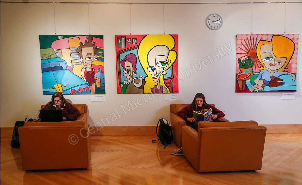 Students study amidst the Corby Blem exhibit in The Baber Room in the Park Library at Central Michigan University. Photo by Steve Jessmore/ Central Michigan University