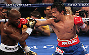 LAS VEGAS, NV - JUNE 09:  (R-L) Manny Pacquiao lands a right to the head of Timothy Bradley during their WBO welterweight title fight at MGM Grand Garden Arena on June 9, 2012 in Las Vegas, Nevada.  (Photo by Jeff Bottari/Getty Images) *** Local Caption *** Manny Pacquiao; Timothy Bradley