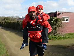 Bristol City's Jay Emmanuel-Thomas gives Connor a piggy back ride to training - Photo mandatory by-line: Dougie Allward/JMP - Mobile: 07966 386802 - 01/04/2015 - SPORT - Football - Bristol - Bristol City Training Ground - HR Owen and SAM FM
