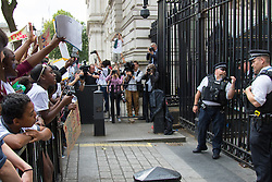 Whitehall, London, August 7th 2015. Following the closure of children's charity Kids Company in the wake of allegations of financial mismanagement, sexual impropriety and claims that some children have used money given to them to buy drugs, supporters and staff of the charity protest, marching to Downing Street demanding that the charity, set up by Camila Batmanghelidjh, be saved.