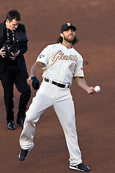 SAN FRANCISCO, CA - APRIL 18:  Madison Bumgarner #40 of the San Francisco Giants throws a baseball into the stands during the 2014 World Series ring ceremony before the game against the Arizona Diamondbacks at AT&T Park on April 18, 2015 in San Francisco, California.  The San Francisco Giants defeated the Arizona Diamondbacks 4-1. (Photo by Jason O. Watson/Getty Images) *** Local Caption *** Madison Bumgarner