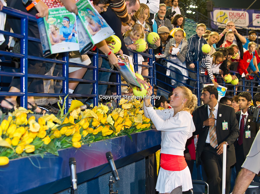Caroline Wozniacki of Denmark signs autographs for fans after defeating Svetlana Kuznetsova of Russia 6-1, 6-3 in the final of the Dubai Duty Free Tennis Championships, held at the Dubai Tennis Stadium in Dubai, UAE, Sunday, February 20th, 2011. Photo by: Stephen Hindley/SPORTDXB