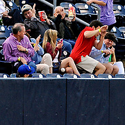 A fan is hit with a foul ball during an NCAA college baseball game between Georgia and Mississippi in Oxford, Miss., Friday, May 9, 2014. (Photo/Thomas Graning)