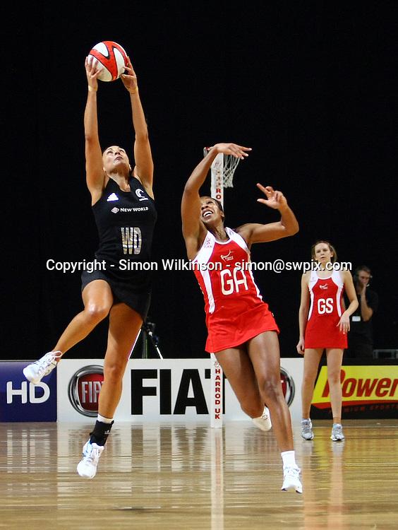 PICTURE BY VAUGHN RIDLEY/SWPIX.COM...Netball - International Netball Series - England v New Zealand - MEN Arena, Manchester, England - 15/01/11...New Zealand's Joline Henry grabs a loose ball as England's Pamela Cookey.