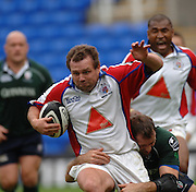 2005/06 Guinness Premiership Rugby, London Irish vs Bristol Rugby; Bristol Rugby, David Hlton, is pulled up short by the tackle from Olivier Magne. Madejski Stadium, Reading, ENGLAND 24.09.2005   © Peter Spurrier/Intersport Images - email images@intersport-images