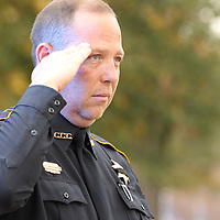 Calhoun County Constable Jayvan Landingham saluts the funeral procession as it passes his post for former Bruce Police Chief Stanley Evans on Saturday.