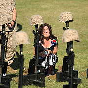 CAMP LEJEUNE, NC  - APRIL 30:  Delma Posey mourns at the memorials for her son Lance Cpl. Gregory Posey at the 2nd Marine Expeditionary Brigade  memorial service Friday, April 30, 2010 in Camp Lejeune, honoring the unit's Marines and sailors killed during their recent deployment to Afghanistan.The 2nd MEB deployed to Afghanistan's Helmand province in April 2009 in support of NATO's International Security Assistance Force.   The unit spent nearly 12 months partnered with Afghan security and other NATO forces prosecuting a highly successful campaign against Taliban and other anti-government forces in southern Afghanistan.  The MEB returned to the United States earlier this month. (Photo by Logan Mock-Bunting/ZUMA Press)