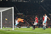 West Ham Goalkeeper Adrian saves Wayne Rooney Forward of Manchester United free kick during the EFL Cup Quater-Final between Manchester United and West Ham United at Old Trafford, Manchester, England on 30 November 2016. Photo by Phil Duncan.