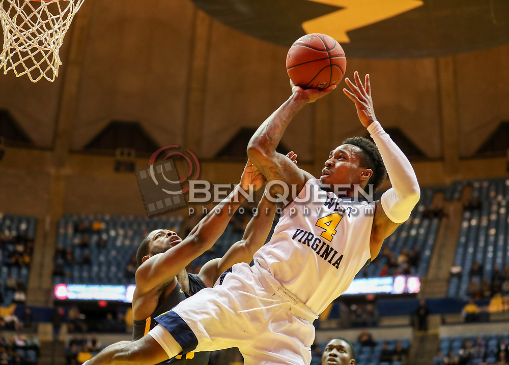 Dec 20, 2017; Morgantown, WV, USA; West Virginia Mountaineers guard Daxter Miles Jr. (4) is fouled on a shot during the second half against the Coppin State Eagles at WVU Coliseum. Mandatory Credit: Ben Queen-USA TODAY Sports