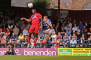 York City defender Femi Illesami wins the header fromCarlisle United defender Tom Miller during the Sky Bet League 2 match between York City and Carlisle United at Bootham Crescent, York, England on 19 September 2015. Photo by Simon Davies.