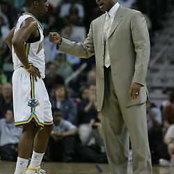 Hornets guard Chris Paul talks with head coach Byron Scott in the fourth quarter of their NBA game against the Chicago Bulls on March 17, 2008 at the New Orleans Arena in New Orleans, Louisiana. The New Orleans Hornets defeated the Chicago Bulls 108-97.