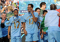 Football - Premier League - Manchester City vs. Queens Park Rangers<br /> Manchester City's Joleon Lescott celebrates with his medal at the Etihad Stadium, Manchester