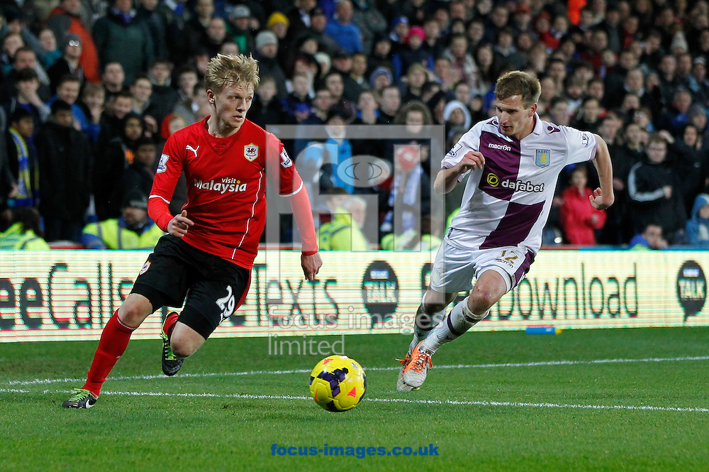 Mats Moller Daehli of Cardiff City and Marc Albrighton of Aston Villa during the Barclays Premier League match at the Cardiff City Stadium, Cardiff<br /> Picture by Mike  Griffiths/Focus Images Ltd +44 7766 223933<br /> 11/02/2014