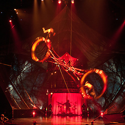 London, UK - 4 January 2012: Acrobats perform at the wheel of Death, a 1600 pound structure that rotates at heart-stopping speeds during the Cirque Du Soleil Kooza dress rehearsal at the Royal Albert Hall. Since its premiere in April of ..2007, KOOZA has captivated close to four million spectators in North America and Japan.  London will be the first destination of the KOOZA European tour starting the ..5th of January. Written and directed by David Shiner, KOOZA is a return to the origins of Cirque du Soleil combining two circus traditions - acrobatic performance and ..the art of clowning.  KOOZA highlights the physical demands of human performance in all its splendor and fragility, presented in a colorful m&eacute;lange that emphasizes ..bold slapstick humor. This image can be quickly and easily purchased from some of the major international stock agencies:<br />