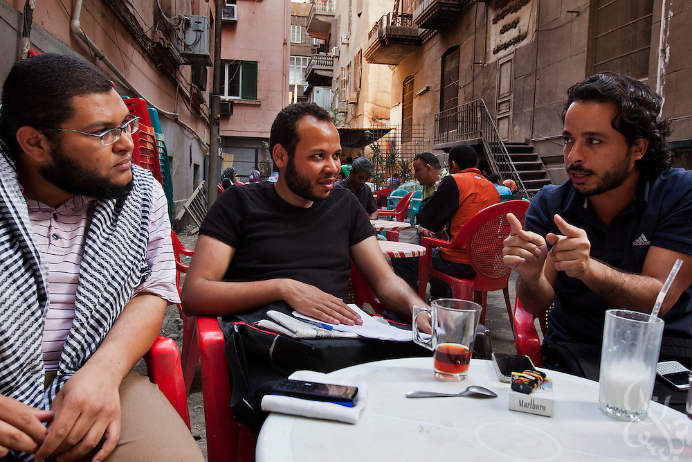 """From left: Salafi supporter Ahmed el Kordi,25, Alexandria youth activist Mohamed Abdel Salam, 23, and leader of the """"Youth for Freedom and Justice"""" Khaled el Sayed, 28, discuss the upcoming presidential election at a street cafe in downtown Cairo, Egypt May 3, 2012. El Kordi and Abdel Salam support Islamist candidate Abdul Moneim Aboul Fotouh, while El Sayed does not."""