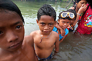 LINGGA, INDONESIA - <br /> <br /> Sea Tribe Children in Indonesia, Last Nomad Tribe Sea in Indonesia<br /> <br />  Children of sea tribal or called sea people were swimming on the sea at Tajur Biru island in Lingga, Riau Islands province, Indonesia.<br /> Sea Tribe or called sea people who inhabit Tajur Biru Island, Lingga Regency, Riau Islands Province - Indonesia, sea people is the last existing tribe. <br /> only 15 families 52 people in total. Sea people are wandering tribes who live in the sea. The indigenous people called the sea because it has characteristics specific life, such as family life in the boat and wander along the waters.<br /> Historically, Sea People used to be a pirate, but it plays an important role in the kingdom of Srivijaya, the Sultanate of Malacca and Johor Sultanate. They keep the straits, repel pirates, guiding traders to harbor , and maintain their hegemony in the region.<br /> ©Exclusivepix Media