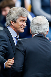 Manager Manuel Pellegrini of Manchester City greets Stoke Manager Mark Hughes - Photo mandatory by-line: Rogan Thomson/JMP - 07966 386802 - 30/08/2014 - SPORT - FOOTBALL - Manchester, England - Etihad Stadium - Manchester City v Stoke City - Barclays Premier League.