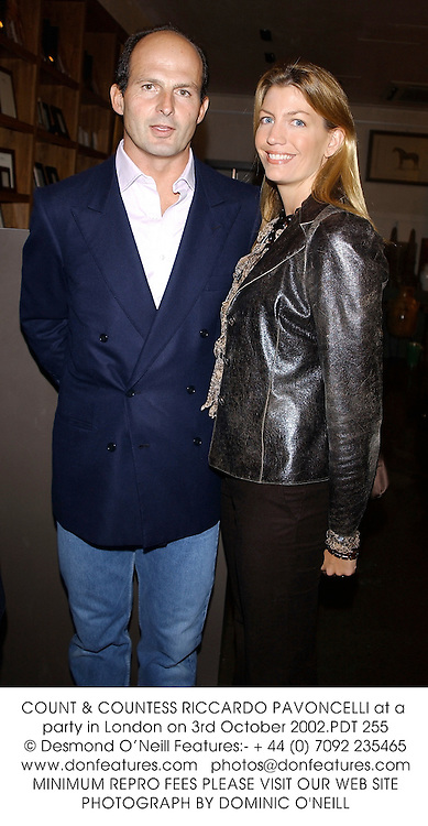 COUNT & COUNTESS RICCARDO PAVONCELLI at a party in London on 3rd October 2002.PDT 255
