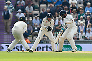 Cheteshwar Pujara of India batting with a fielder in close during day two of the fourth SpecSavers International Test Match 2018 match between England and India at the Ageas Bowl, Southampton, United Kingdom on 31 August 2018.